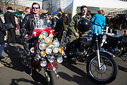 The Classic Car Boot Sale at the Southbank Centre, South Bank, London, UK. Vintage cars, fashion and style assemble together to celebrate all things classic from the 1940s to 1960s. Mod on a classic rocker motorbike and a rocker on a Vespa scooter. Turning the original ideal on it's head.