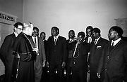 "06/05/1965<br /> 05/06/1965<br /> 06 May 1965<br /> African Students on a visit to Dublin. A group of African students of Catholic Sociology from Claver House, London, on an educational holiday to Ireland. The group stayed with Irish families under the auspices of ""Le Cheile"" a group that promoted friendship and exchange of culture between Irish and overseas people. the students were entertained by His Grace, Most Rev. Dr. McQuaid, Archbishop of Dublin to a visit to the Dublin Institute of Catholic Sociology. Photo Shows Archbishop McQuaid chatting to the students while Fr. Stefan Haule (Tanzania) takes the opportunity to take a photograph."
