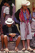 GUATEMALA, HIGHLANDS, MARKETS portrait of Indian men at market wearing traditional textiles, in village of Santiago on Lake Atitlan