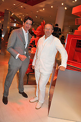 Left to right, EDWARD HIRST and NICK ASHLEY at an exhibition at The Conran Shop entitled Red to celebrate 25 years of The Conran Shop at the Michelin Building, 81 Fulham Road, London on 19th September 2012.