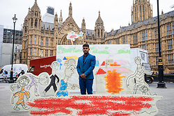 © Licensed to London News Pictures. 23/08/2018. London, UK. Salah Udin, the first Rohingya to be given citizenship in the UK stands by a 3D installation  in Westminster, made using drawings from Rohingya children depicting the horrific attacks which forced them to flee Myanmar to Bangladesh. The stunt, organised by Save the Children, is calling for Jeremy Hunt to refer the perpetrators of these attacks to the International Criminal Court. Photo credit : Tom Nicholson/LNP