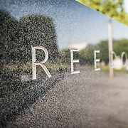 "Korean War Memorial Freedom. The word ""Freedom"" is etched in to the granite wall of the Korean War Veterans Memorial. At the very right of frame, the lighter figures, out of focus, are reflections of the The Column of statues of soldiers that forms the centerpiece of the monument."