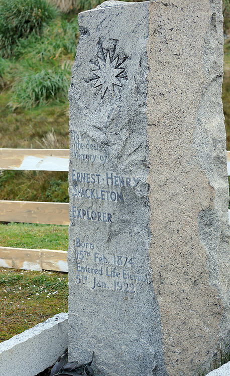 The stone on the grave of Sir Ernest Shackleton in Grytviken Cemetery near the rusting ruins of the whaling station. The stone is simply  inscribed with a nine pointed star and the words:<br />  'To the dear memory of Ernest Henry Shackleton <br /> Explorer <br /> Born<br /> 15th Feb. 1874 <br /> Entered Life Eternal 5th Jan.1922'.  <br /> Grytviken, King Edward Cove, .South Georgia 20Feb16
