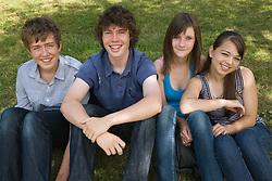 Group of teenagers smiling in the park,