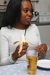 Black girl eating a banana