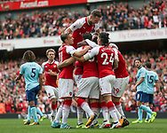 The Arsenal players celebrate their first goal scored by Danny Welbeck.  Premier league match, Arsenal v AFC Bournemouth at the Emirates Stadium in London on Saturday 9th September 2017. pic by Kieran Clarke, Andrew Orchard sports photography.