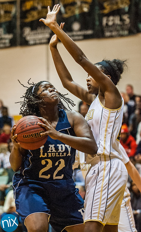 Hickory Ridge's Zhara Brown looks to shoot against Concord's Alisha Vinson Friday night at Concord High School. Hickory Ridge won the game 55-35.