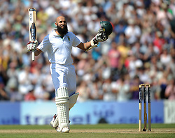 South Africa's Hashim Amla celebrates reaching his triple centaury during the Investec first test match at the Kia Oval, London.