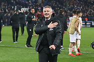 Manchester United interim Manager Ole Gunnar Solskjaer celebrates with hand on his crest during the Champions League Round of 16 2nd leg match between Paris Saint-Germain and Manchester United at Parc des Princes, Paris, France on 6 March 2019.