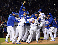 CHICAGO, IL - OCTOBER 22: The Chicago Cubs celebrate winning the National League pennant after defeating the Los Angeles Dodgers in Game 6 of the NLCS at Wrigley Field on Saturday, October 22, 2016 in Chicago, Illinois. (Photo by Ron Vesely/MLB Photos via Getty Images)