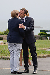 French President Emmanuel Macron and his wife Brigitte Macron welcome German Chancellor Angela Merkel at the Biarritz lighthouse, southwestern France, ahead of a working dinner on August 24, 2019, on the first day of the annual G7 Summit. Photo by Thibaud Moritz/ABACAPRESS.COM