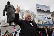 After threee and a half years of political upheavel in the British parliament, a Winston Churchill and Boris Johnson lookalike stands beneath the Church statue in Parliament Square, as Brexiteers celebrate in Westminster on Brexit Day, the day when the UK legally leaves the European Union, on 31st January 2020, in London, England.