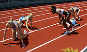 Paula Radcliffe loses her glasses in a fall in the women's 1,500 meters while Ethiopia's Mestawat Tadesse quickly climbs to her feet. Jen Toomey (6) and Shalane Flanagan (16) also fell in the race  in the 31st Prefontaine Classic, Saturday, June 4, 2005, in Eugene, Ore.