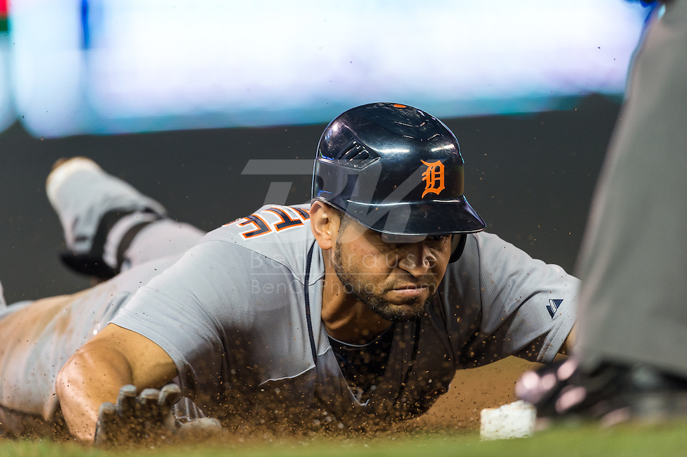 Omar Infante (4) of the Detroit Tigers slides safely into 3rd base for a triple during the fifth inning against the Minnesota Twins on August 14, 2012 at Target Field in Minneapolis, Minnesota.  The Tigers defeated the Twins 8 to 4.  Photo: Ben Krause