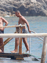 EXCLUSIVE: Ruud Gullit in bathing suit and his wife Maggie Jimenez in bikini are seen on the beaches of Ibiza while they enjoy their holidays in Ibiza on July 22, 2017 in Ibiza, Spain. 22 Jul 2017 Pictured: Ruud Gullit. Photo credit: Elkin Cabarcas / MEGA TheMegaAgency.com +1 888 505 6342