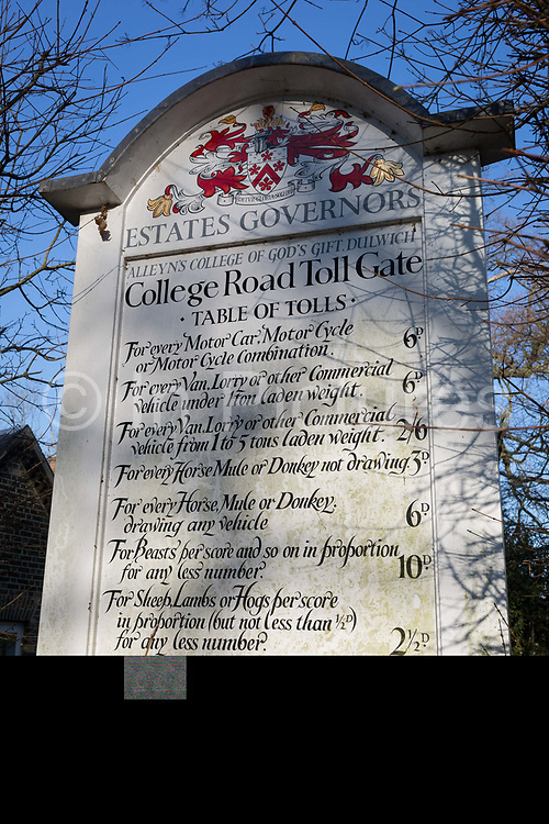 The sign from the Dulwich Estates explaining tolls for the College Road tollgate, present there since the 18th century and now the last remaining tollgate in London, on 23rd February 2019, in London, England.