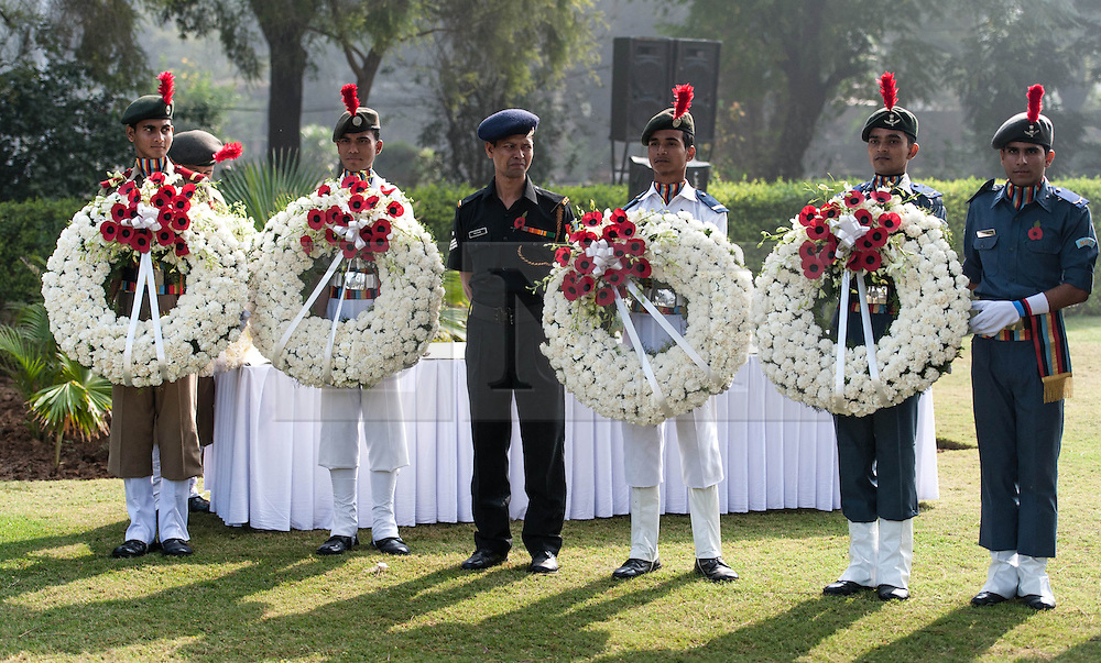 © Licensed to London News Pictures. 11/11/2012. Delhi, India. Members of the Indian Army, Navy and Air Force hold wreathes with poppies during a Remembrance Day ceremony held at the Delhi War Cemetery, India, today. Remembrance Day (also known as Poppy Day or Armistice Day) is a memorial day observed in Commonwealth countries since the end of World War I to remember the members of their armed forces who have died in the line of duty. This day, or alternative dates, are also recognized as special days for war remembrances in many non-Commonwealth countries. Remembrance Day is observed on 11 November to recall the end of hostilities of World War I on that date in 1918.   Photo credit : Richard Isaac/LNP