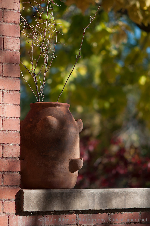 Strawberry planter on a brick bungalow porch in the Don Gaspar Historical District in Santa Fe, NM. The photograph was taken in the afternoon sun in mid October.