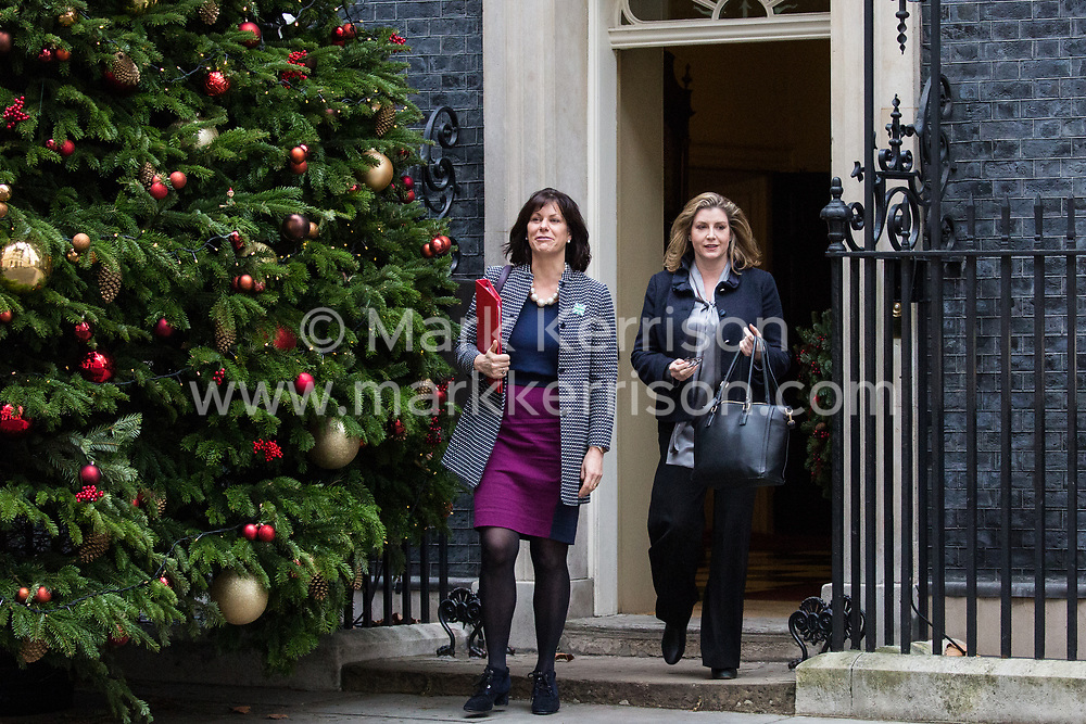 London, UK. 18th December, 2018. Claire Perry MP, Minister for Energy and Clean Growth at the Department of Business, Energy and Industrial Strategy, and Penny Mordaunt MP, Secretary of State for International Development, leave 10 Downing Street following the final Cabinet meeting before the Christmas recess. Topics discussed were expected to have included preparations for a 'No Deal' Brexit.