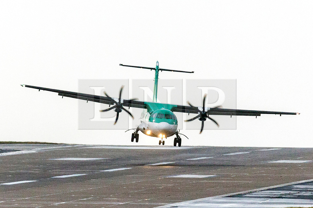 © Licensed to London News Pictures. 10/03/2020. Leeds UK. A Aer Lingus aircraft is blown about as it attempts to land in the strong winds this morning at Leeds Bradford airport in Yorkshire as the UK is battered by more bad weather. Photo credit: Andrew McCaren/LNP