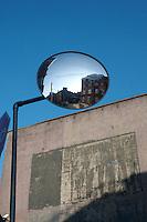 Buildings reflected in circular traffic mirror in Dublin Ireland