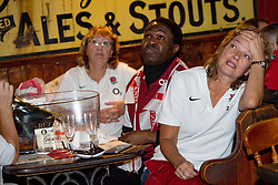 England fans react during a screening of the Rugby World Cup Final at The Merchants Inn in Rugby, Warwickshire.