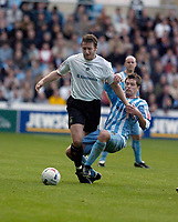 Photo: Leigh Quinnell.<br /> Coventry City v Luton Town. Coca Cola Championship.<br /> 29/10/2005. Lutons Steve Howard is challenged by Coventrys Stephen Hughes.