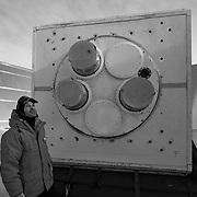 John Kovac, PI for the Keck Array upgrade project standing next to the Keck Array Telescope inside the rooftop ground shield on the roof of the Martin A Pomerantz Observatory, South Pole.