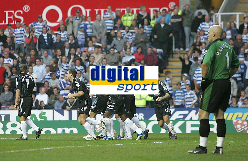 Photo: Lee Earle.<br /> Reading v Chelsea. The Barclays Premiership. 14/10/2006. Reading keeper Marcus Hahnemann (R) looks dejected after his own goal put Chelsea ahead. Chelsea players celebrate their goal.