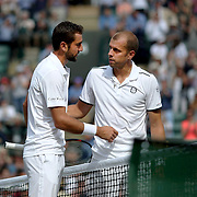 LONDON, ENGLAND - JULY 12:  Gilles Muller of Luxembourg congratulates Marin Cilic of Croatia on his win in the Mens' Singles Quarter Final match on Court One during the Wimbledon Lawn Tennis Championships at the All England Lawn Tennis and Croquet Club at Wimbledon on July 12, 2017 in London, England. (Photo by Tim Clayton/Corbis via Getty Images)