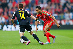 Neil Taylor of Wales (Swansea City) is challenged by Dries Mertens of Belgium (Napoli) - Photo mandatory by-line: Rogan Thomson/JMP - 07966 386802 - 12/06/2015 - SPORT - FOOTBALL - Cardiff, Wales - Cardiff City Stadium - Wales v Belgium - EURO 2016 Qualifier.