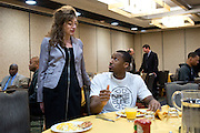 UConn President Susan Herbst speaks with Lasan Kromah during the team lunch at the Hyatt Regency in Dallas, Texas before watching her school compete in the NCAA Final Four on April 5, 2014. (Cooper Neill / for The New York Times)
