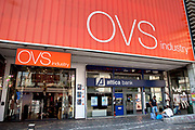 OVS Industry fashion outlet shop in Monastiraki with a large sign above the entrance to Attica Bank. Athens is the capital and largest city of Greece. It dominates the Attica periphery and is one of the world's oldest cities, as its recorded history spans around 3,400 years. Classical Athens was a powerful city-state. A centre for the arts, learning and philosophy.