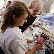 SAN BERNARDINO, CA, June 14, 2007: Sharon Rogone, a former Neonatal Intensive Care Unit (NICU) nurse turned innovator and businesswoman, formed a company called Small Beginnings Inc, which specializes in medical supplies to care and treat premature infants. Her inventions, including the tiny diaper called the Cuddle Buns Diaper, earned her a place in the Smithsonian's Lemelson Center for the Study of Invention and Innovation. She visits with a nurse caring for a preemie.