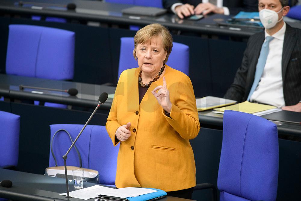 24 MAR 2021, BERLIN/GERMANY:<br /> Angela Merkel, CDU, Bundeskanzlerin, waehrend der Regierungsbefragung durch den Bundestag zur Bekaempfung der Corvid-19 Pandemie, Plenarsaal, Reichstagsgebaeude, Deutscher Bundestag<br /> IMAGE: 20210324-01-013<br /> KEYWORDS: Corona