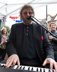"© Licensed to London News Pictures. 04/06/2012. London, England. .Chas Hodges from 'chas & dave"" plays at A traditional East End street party celebrating the Diamond Jubilee outside the Golden Heart Pub in the Spitalfields area of London..The Royal Jubilee celebrations. Great Britain is celebrating the 60th  anniversary of the countries Monarch HRH Queen Elizabeth II accession to the throne this weekend Photo credit : RICH BOWEN/LNP"