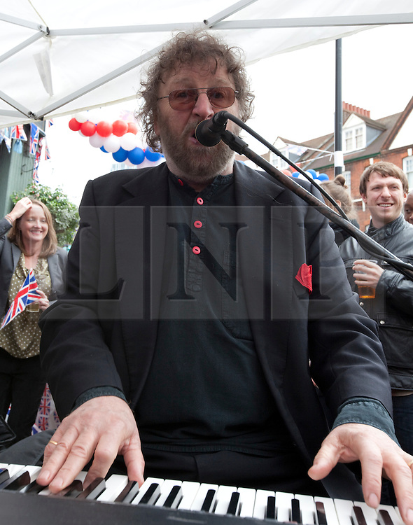 """© Licensed to London News Pictures. 04/06/2012. London, England. .Chas Hodges from 'chas & dave"""" plays at A traditional East End street party celebrating the Diamond Jubilee outside the Golden Heart Pub in the Spitalfields area of London..The Royal Jubilee celebrations. Great Britain is celebrating the 60th  anniversary of the countries Monarch HRH Queen Elizabeth II accession to the throne this weekend Photo credit : RICH BOWEN/LNP"""