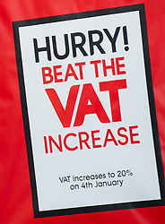 © under license to London News Pictures.  02/01/2011 A shopper walks past a sign showing the VAT increase. The VAT will increase to 20% on the 4th of January 2011. Picture credit should read: David Hedges/LNP.