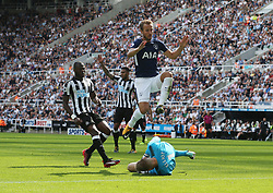 13 August 2017  : Premier League Football : Newcastle United v Tottenham Hotspur:  Harry Kane of Tottenham leaps over Newcastle goalkeeper Rob Elliot: Photo: Mark Leech