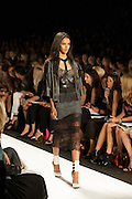 A lacy black dress with gray skirt and leather jacket at the BCBGMAXAZRIA show at the Spring 2013 Mercedes Benz Fashion Week show in New York.