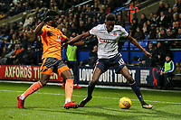 Bolton Wanderers' Sammy Ameobi competing with Reading's Liam Moore<br /> <br /> Photographer Andrew Kearns/CameraSport<br /> <br /> The EFL Sky Bet Championship - Bolton Wanderers v Reading - Tuesday 21st November 2017 - Macron Stadium - Bolton<br /> <br /> World Copyright © 2017 CameraSport. All rights reserved. 43 Linden Ave. Countesthorpe. Leicester. England. LE8 5PG - Tel: +44 (0) 116 277 4147 - admin@camerasport.com - www.camerasport.com