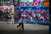 Skateboarders film each others tricks and skills at the Southbank. This area is set aside for skateboarding, BMX bikes etc. and anything hip hop art / grafitti orientated.
