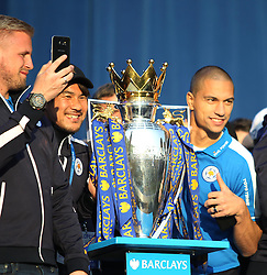 Shinji Okazaki (C) and Gokhan Inler (R) with the trophy at Victoria park during the victory celebrations  - Mandatory by-line: Jack Phillips/JMP - 16/05/2016 - FOOTBALL - Leicester City FC, Sky Bet Premier League Winners 2016 - Leicester City Victory Parade