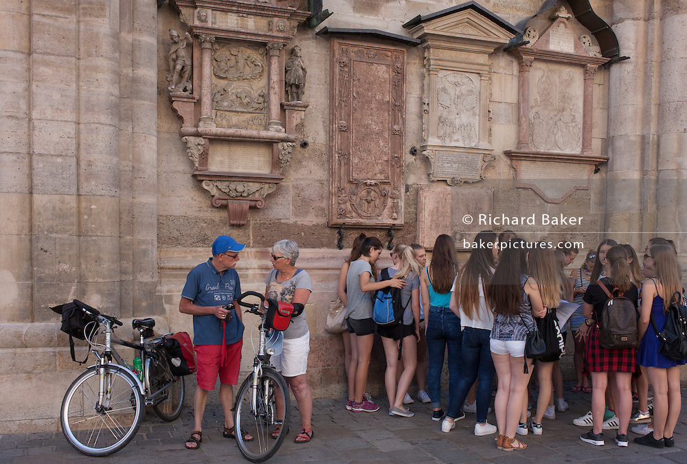 Middle-age cyclists and teenagers outside St. Stephen's Church in Vienna, Austria, EU.