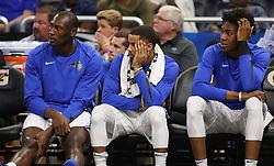 December 6, 2017 - Orlando, FL, USA - Left to Right, Orlando Magic center Bismack Biyombo (11), Orlando Magic guard D.J. Augustin (14) and Orlando Magic forward Wes Iwundu (25) watch the game from the bench -- <br />The Orlando Magic hots the Atlanta Hawks at Amway Center, on Wednesday, December 6, 2017.<br />The Magic won the game in overtime play 110-106. (Credit Image: © Ricardo Ramirez Buxeda/TNS via ZUMA Wire)
