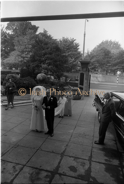 """16/09/1967<br /> 09/16/1967<br /> 16 September 1967<br /> Wedding of Mr Francis W. Moloney, 28 The Stiles Road, Clontarf and Ms Antoinette O'Carroll, """"Melrose"""", Leinster Road, Rathmines at Our Lady of Refuge Church, Rathmines, with reception in Colamore Hotel, Coliemore Road, Dalkey. Image shows the bride arriving at the church before  the ceremony with her father Mr Dudley O'Carroll and sister Gladys McGloughlin."""