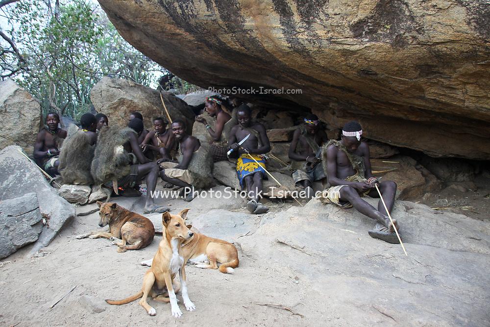 Hadza men prepare arrows before a hunting expedition Photographed at Lake Eyasi, Tanzania