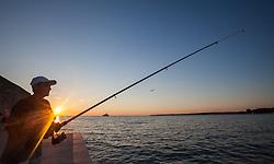 THEMENBILD - URLAUB IN KROATIEN, ein Angler beim fischen bei Sonnenuntergang, aufgenommen am 03.07.2014 in Porec, Kroatien // a fisherman while fishing at sunset at Porec, Croatia on 2014/07/03. EXPA Pictures © 2014, PhotoCredit: EXPA/ JFK