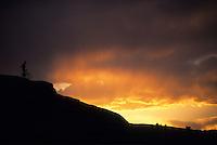 A mountain biker enjoys the sunset while riding slickrock near Moab, Utah.