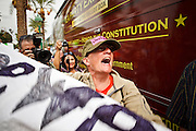 22 OCTOBER 2010 - PHOENIX, AZ:  LIZ HOURICAN, an anti-Tea Party protester, shouts at Sarah Palin at a Tea Party rally Friday. About 300 people attended a Tea Party rally on the lawn of the Arizona State Capitol in Phoenix Friday. They demanded lower taxes, less government spending, repeal of the health care reform bill, and strengthening of the US side of the US - Mexican border. They listened to Arizona politicians and applauded wildly when former Alaska Governor Sarah Palin and her son, Trig, made a surprise appearance. The event was a part of the Tea Party Express bus tour that is crossing the United States.     Photo by Jack Kurtz